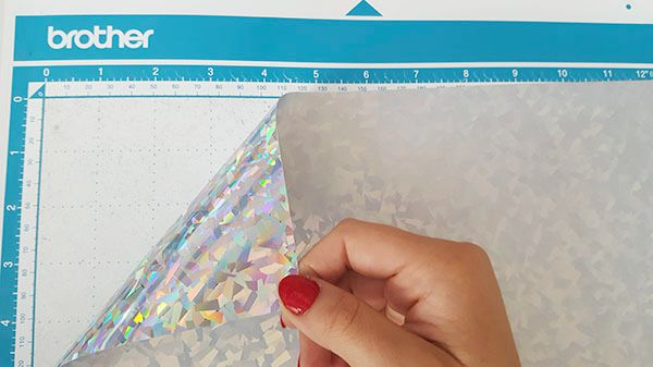 Place the shiny side with the carrier face down on the cutting mat