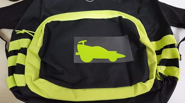 Lime EasyWeed on a backpack