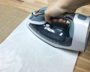how to iron on Glitter HTV to burlap