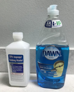Either a mix of water and isopropyl alcohol or dawn dish soap can be used to clean and prep the surface