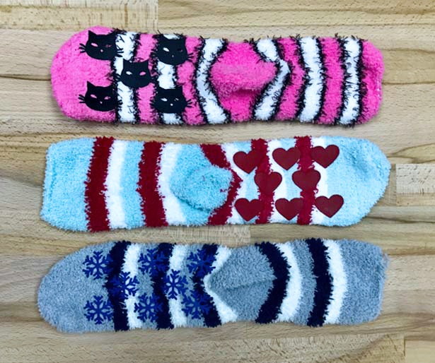 Iron on sock grips for fuzzy socks in snowflakes, hearts, and kitty cat faces.