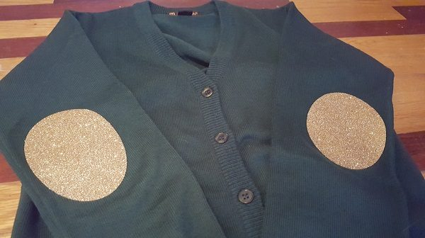 Old gold Glitter elbow patches on a 100% acrylic cardigan sweater
