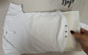 A Heat Press Pillow inside a onesie