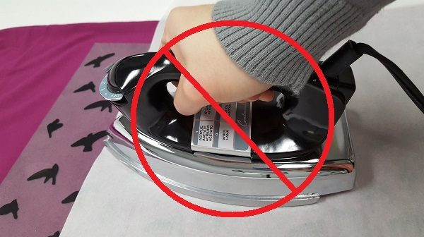 Do not use a home iron on heat sensitive materials