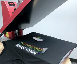 Position modal t-shirt and arrange heat transfer vinyl pieces on top