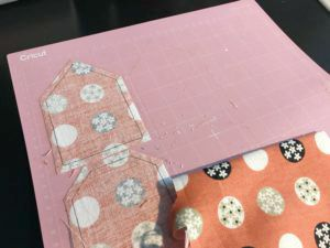 peel excess fabric away from cutting mat