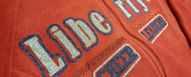Siser Glitter heat pressed on a fleece zip jacket