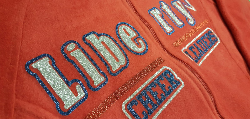 Siser Glitter heat pressed on a fleece zip jacket