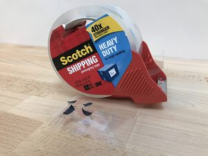 Use Packing tape to make an HTV scrap catcher for easy clean up