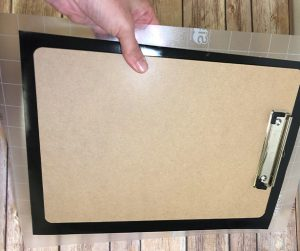 Squeegee Chalkboard EasyPSV to adhere it to the back of the clipboard