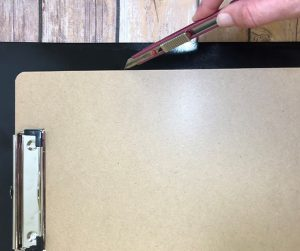 Trim the excess chalkboard EasyPSV with a craft knife