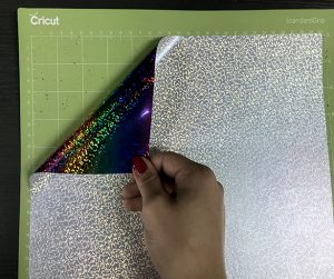 Holographic HTV always goes color side down on the cutting mat