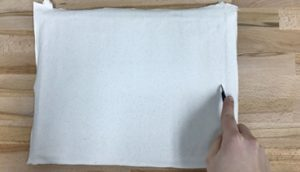 Use an exacto knife to trim the excess canvas on each side.