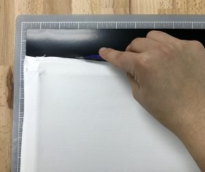 Cut BlackBoard HTV to the same size as the cotton canvas
