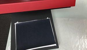 Use a heat press to apply BlackBoard heat transfer vinyl
