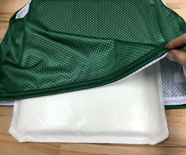 Place a heat transfer pillow inside the mesh jersey