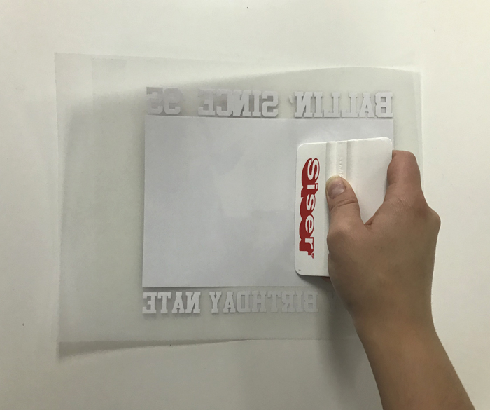 Apply pressure with a squeegee to transfer the printed EasySubli to the mask