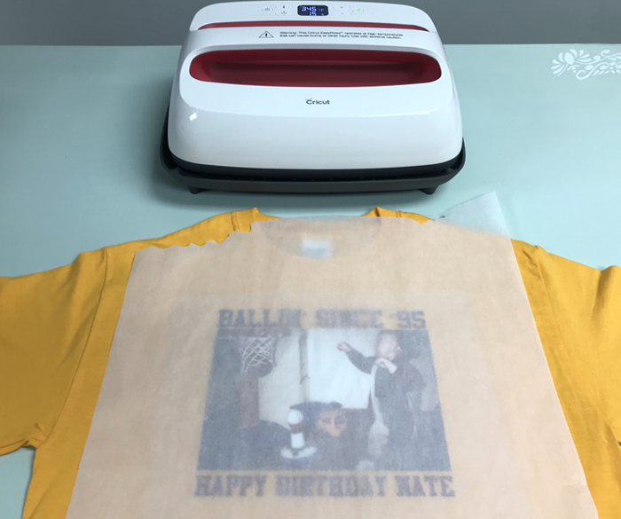 Center EasySubli on the cotton shirt and cover with parchment paper